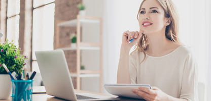 woman using personal savings account on computer