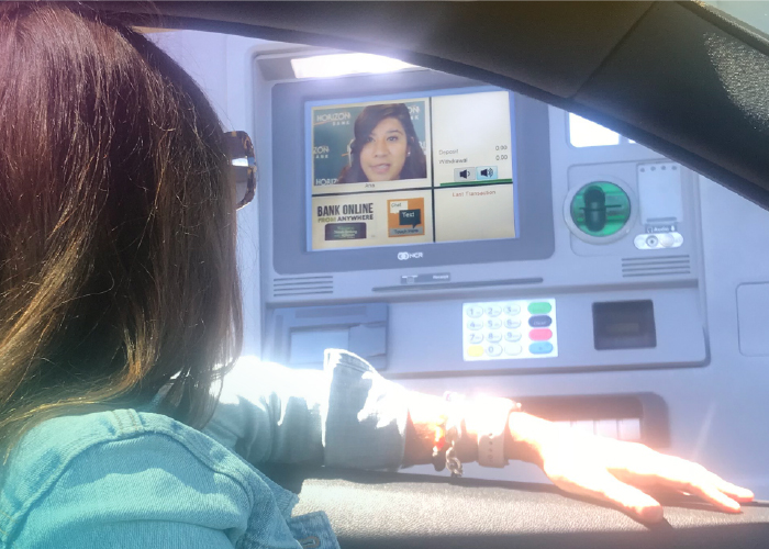 girl in car sitting at the Live Video Banking driveup