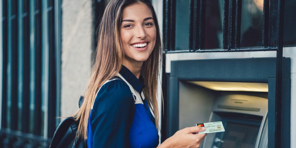 Student at ATM machine